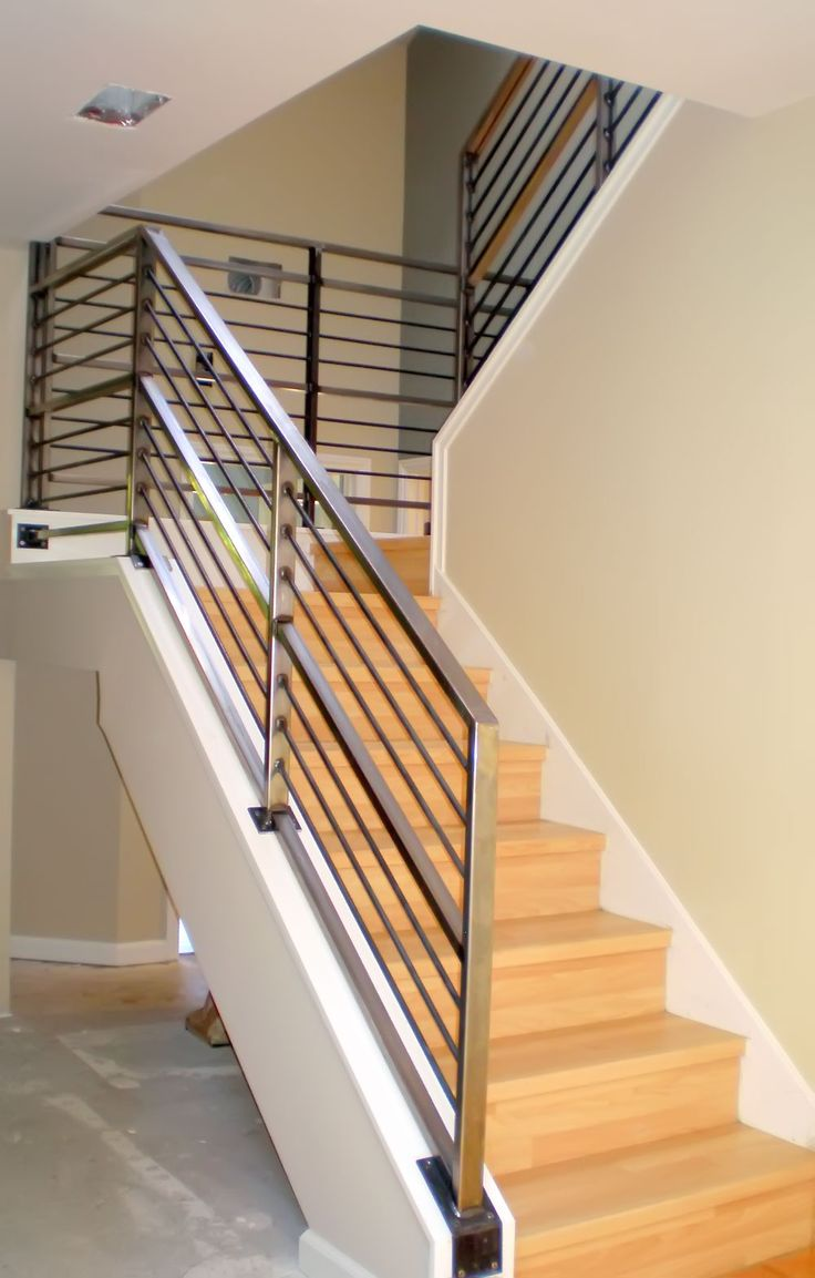 Modern Neutral Wooden Staircase With Minimalist Steel Railing Railings Inside And Out