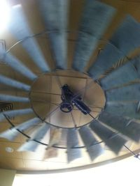An actual windmill used as a ceiling fan.   Everything ...