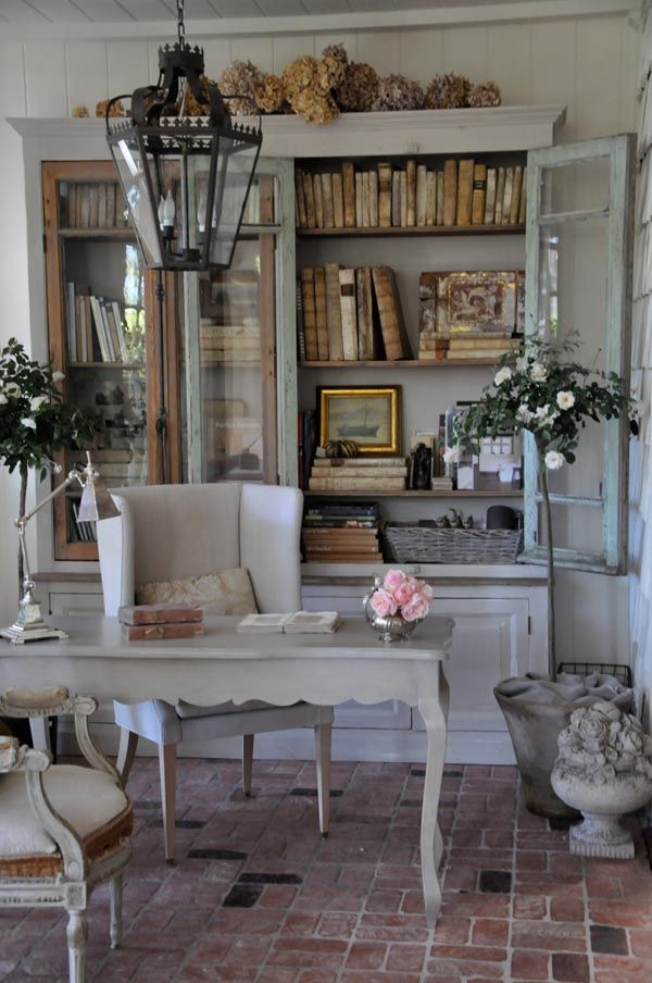 Wonderful idea … use china cabinet for library! I like how it looks old. I thi