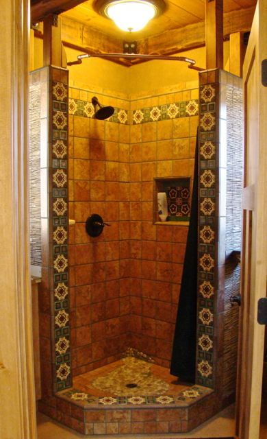 A shower designed by Kim trimmed in Mexican Talavera tile An OnDemand water heater supplies