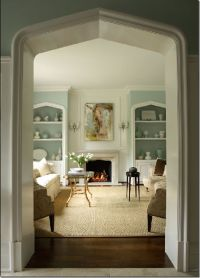 Living room with Tudor arches on the fireplace, door, and ...
