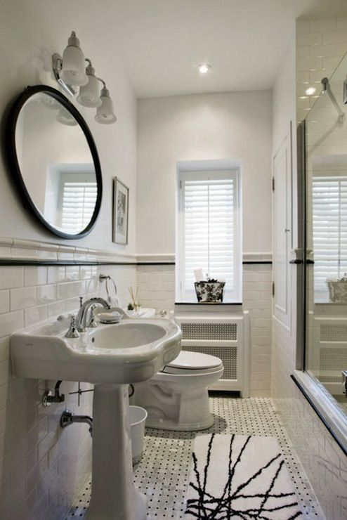 Long bathroom design with white walls paired with subway