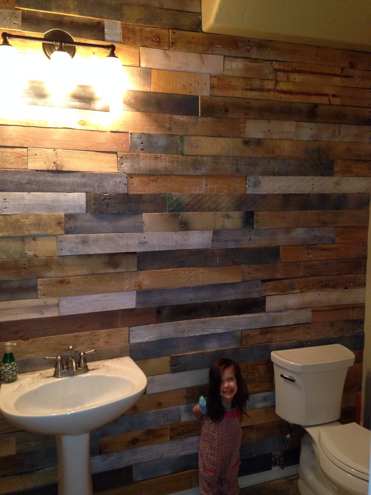Pallet wood slats accent wall in our bathroom I did. And