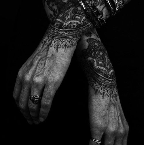 aged hands and black lace tattoo