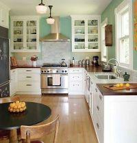 White cabinets, aqua walls, and wooden butcher block ...
