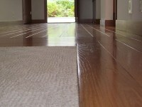 Low-pile carpeting recessed into wood floors completes ...
