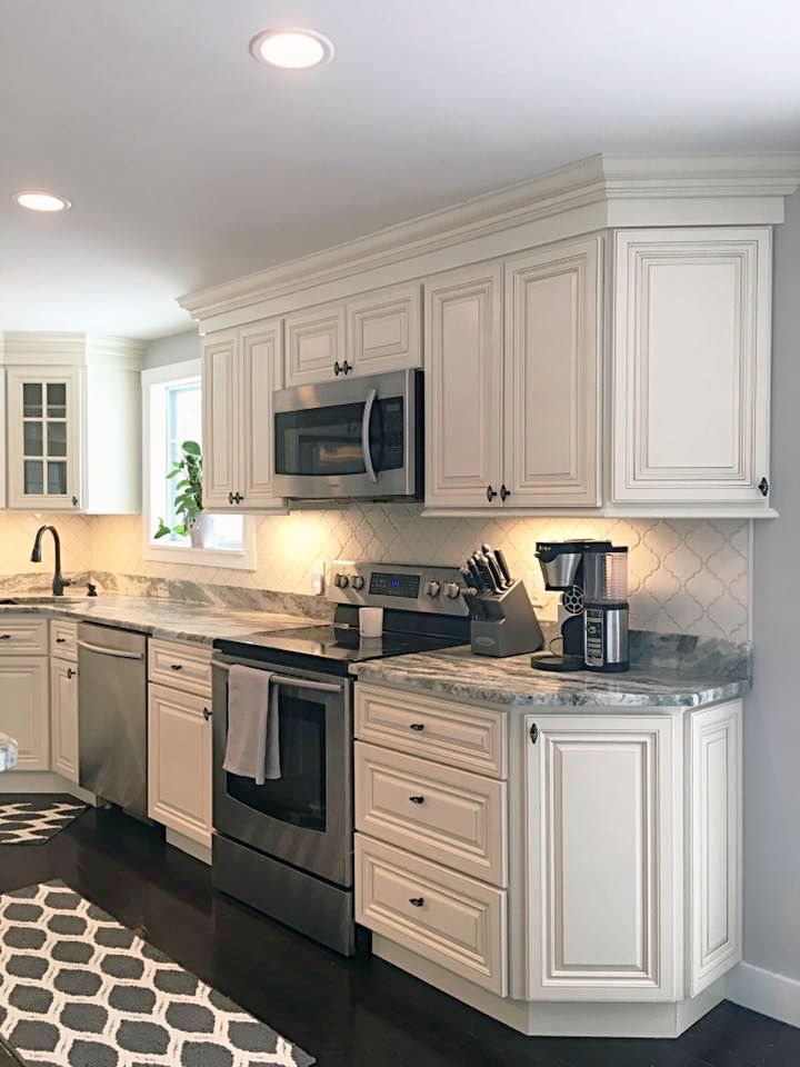 french country kitchen lighting natural wood cabinets jsi cabinetry's wheaton with fantasy brown ...