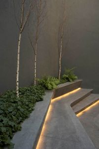 Use LED strip lights under the steps and create an ...