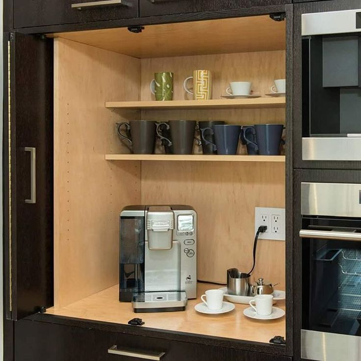 A Hidden Coffee Bar Kitchen Beverage Center With Space For A Coffee Maker And Other Appliances