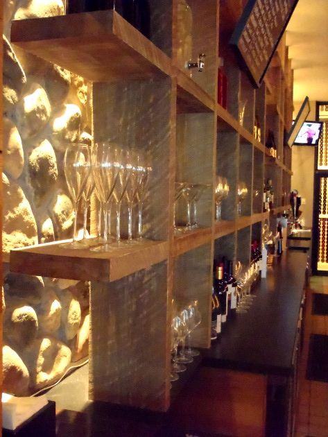 Back Lighting On Stone Wall With Rustic Shelving Makes A