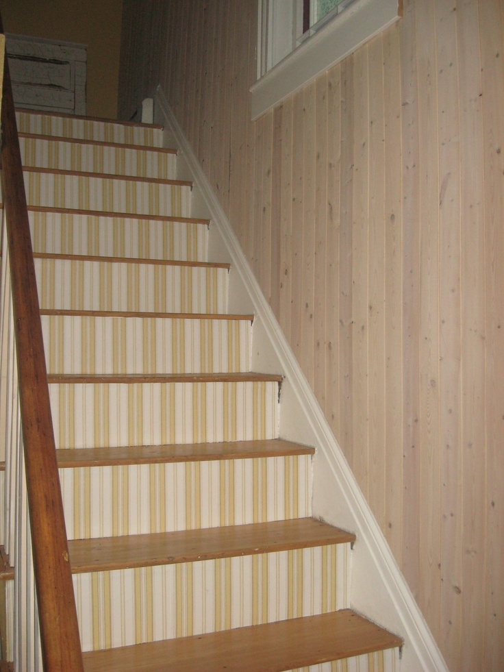 wallpapered stairs with white washed pine panels on the