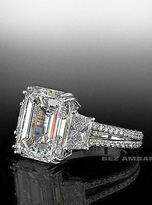 Emerald cut center stone trio with split shank mounting by