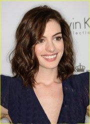 tousled medium length brown hairstyle