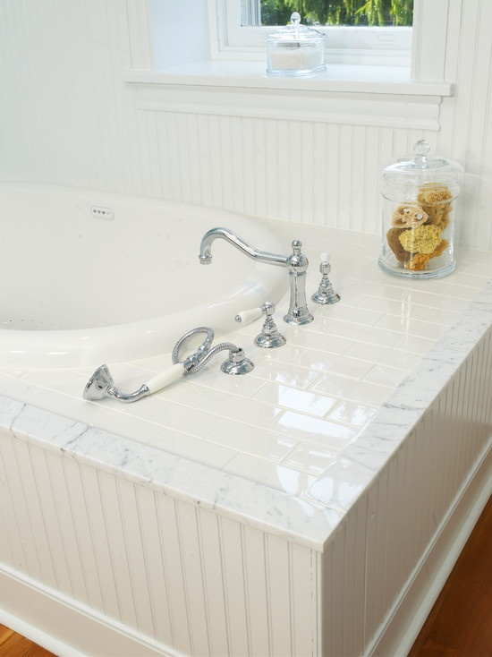 Soaking Tub With Subway Tile Surround And Marble Field