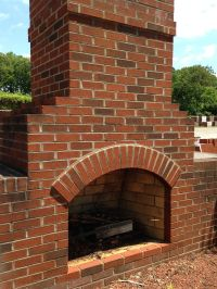 A classic outdoor fireplace constructed out of Old ...