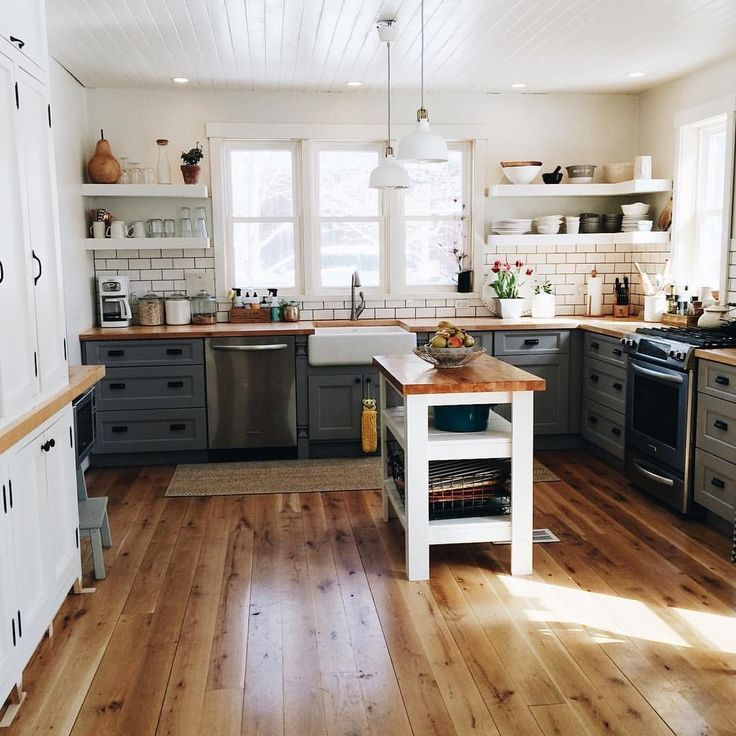 I love the butcher block countertops and dark grout subway tile in this country kitchen See this Instagram photo by