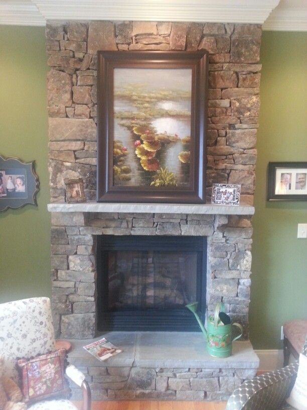 Full height stone fireplace with raised hearth dont want