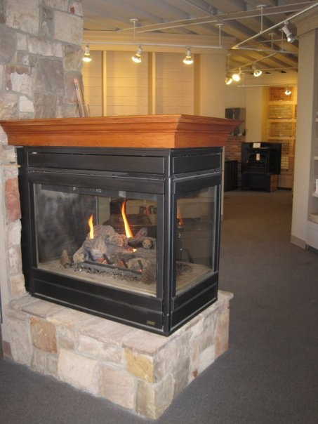 Three sided gas fireplace Also availale in two sided  Young Brothers  Daley Lansing MI
