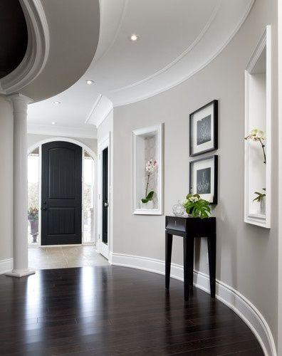 Gray walls, white trim, dark hardwood floors, Black