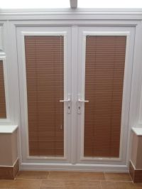 A set of perfectfit venetian blinds in French doors by ...