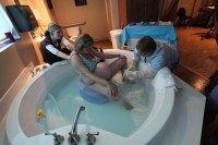 Using the Kaya birth stool in the tub! | Dream Birthhouse ...