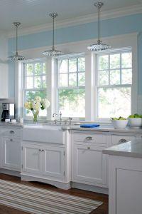 Glass pendant lighting, white farm sink, kitchen windows ...