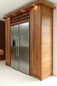 Tall pull-out storage and wine rack surround the Liebherr ...