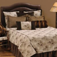 The Pine Forest cabin bedding has a simple pine cone and