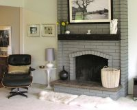 Painted brick fireplace in a light gray with dark wood ...