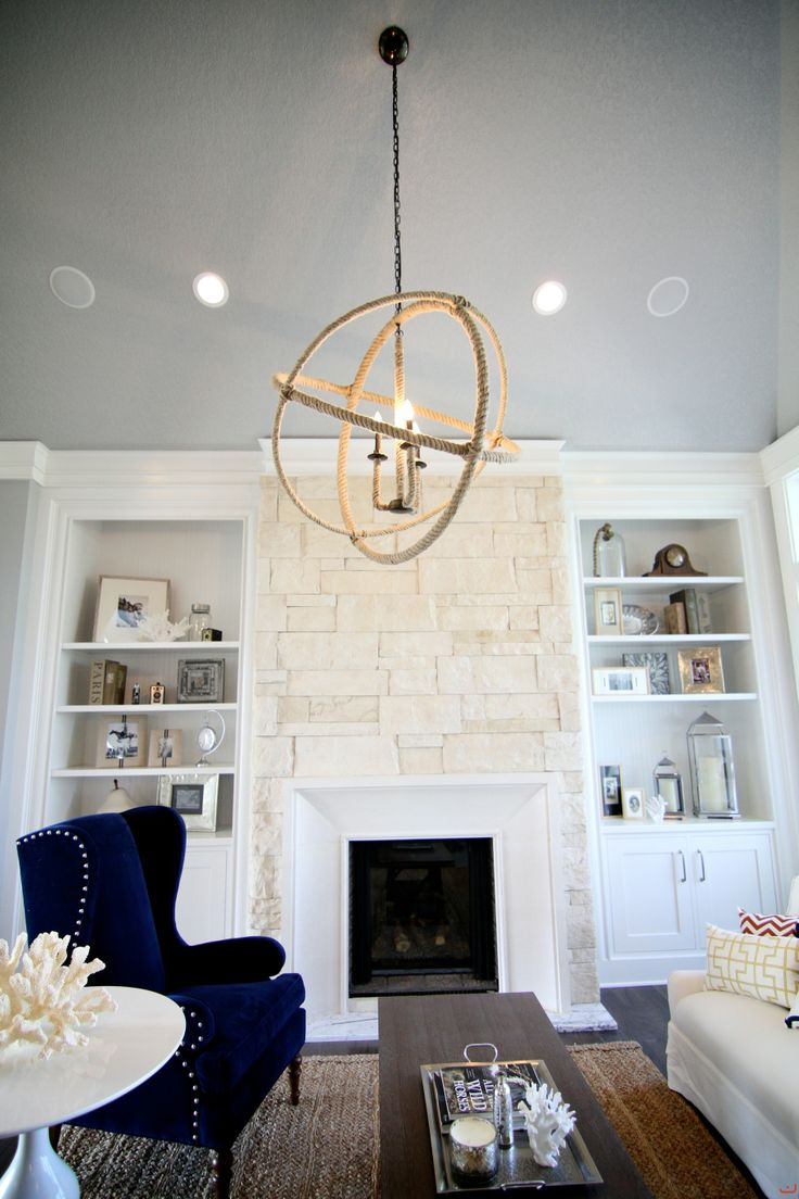 How To Build In A Gas Fireplace Built-in Shelving Around The White Stone Fireplace. And