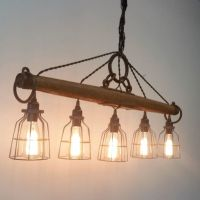 This modern rustic chandelier, featuring five lights, is ...