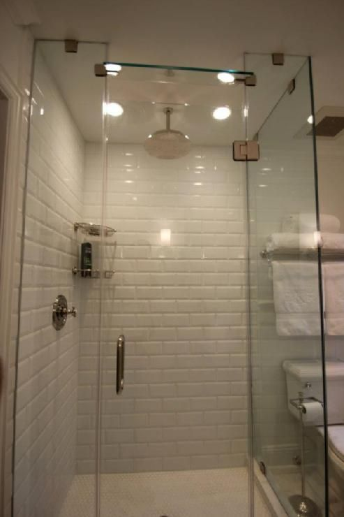 Wihte subway tile surround  penny tiles on floor Too antiseptic for me  Bathrooms
