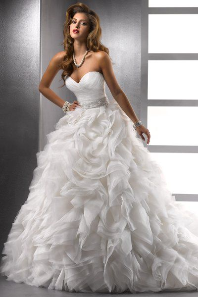 Jerrica – 72803 A grand statement of breathtaking elegance, this ball gown silhouette features a deep sweetheart neckline and