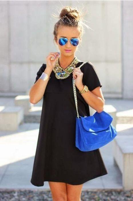 Flowy black mini, statement necklace, topknot, aviators -- this looks so cute!: