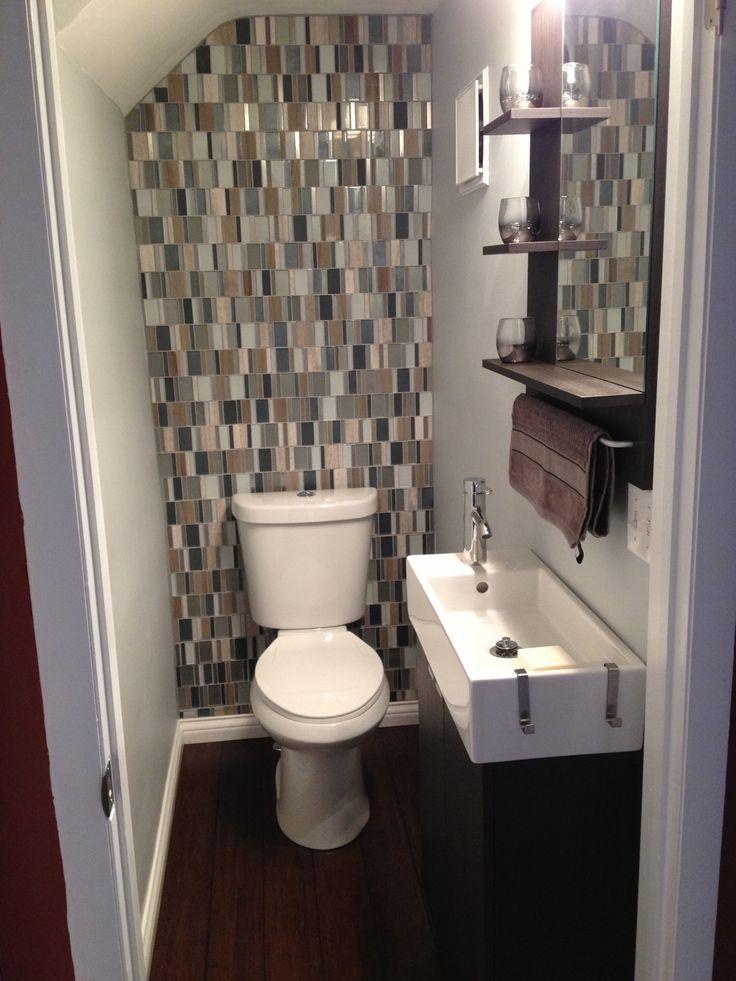 Small bathroom with glass tile backsplash