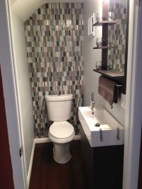 Small bathroom with glass tile backsplash