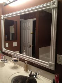 DIY bathroom mirror frame. White styrofoam molding, wood