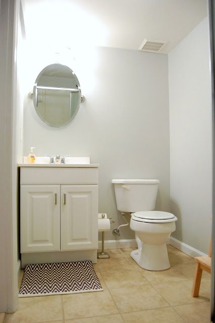 Basement bathroom with light gray blue wallsmix of Behrs Sterling and Dolphin Fin  The