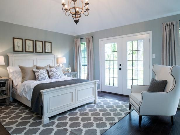 Hgtv Check Out This Newly Redesigned Master Bedroom Has Dark Wood Floors Large Windows