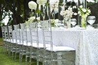 White swirls table cloth, clear Tiffany chairs, white ...