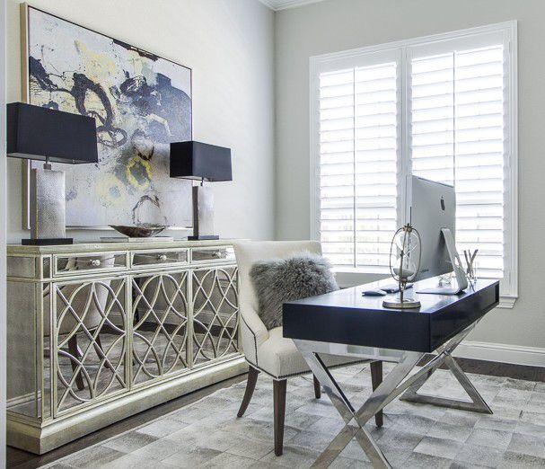 EJ Interiors  gray cowhide rug mirrored credenza