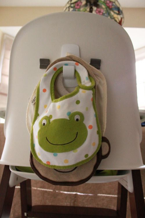 Use a command hook to hang bibs behind highchair…smart!