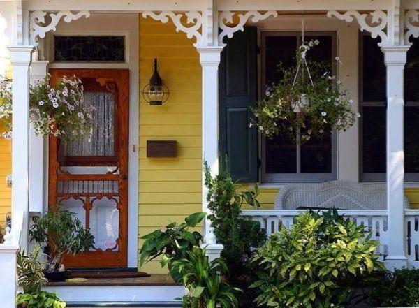 Victorian Porch with ornate scroll woodwork at the top