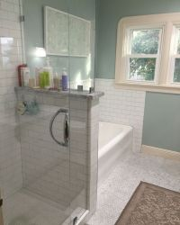 Frameless shower door, pony wall with marble top, subway ...