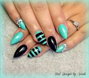teal & black stiletto nails nailed