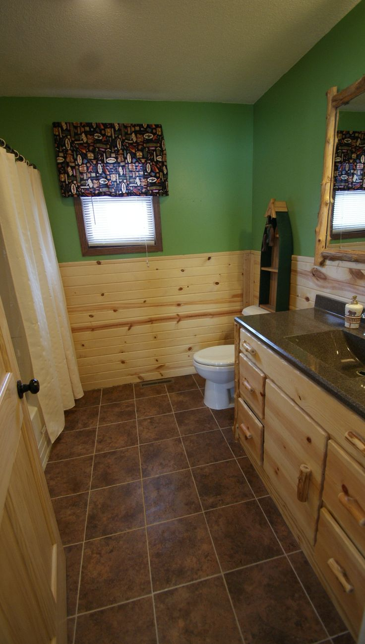 Bathroom with custom log vanity cabin vanity tile