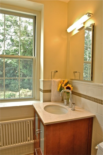 soft yellow bathroom ideas Soft yellow hue bathroom with off-white subway and glass