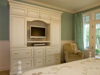The elegant white armoire provides functional storage and ...