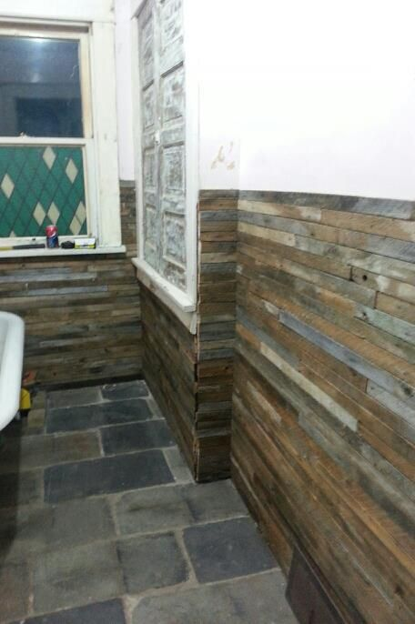 reclaimed wood lath walls and slate roof flooring in the