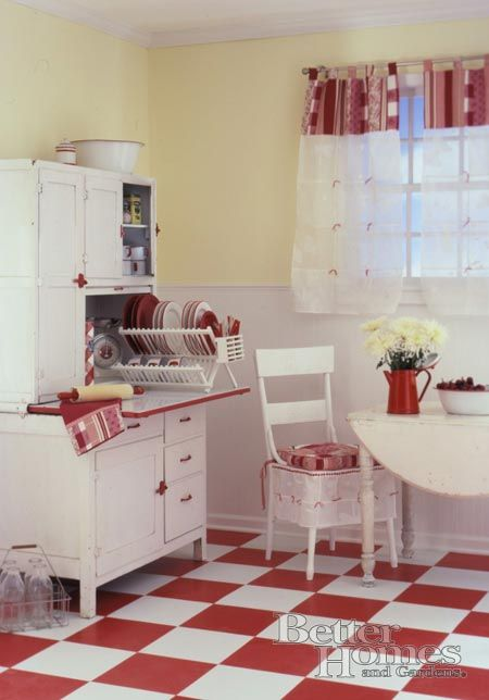 Red & white retro kitchen. I like the pale yellow on the